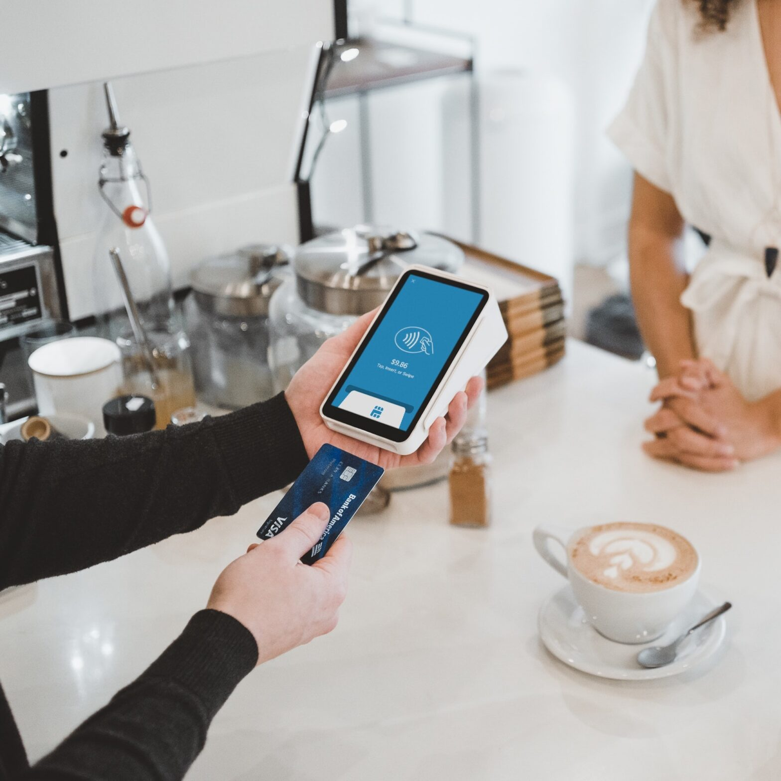 Customer journey that converts - a person making payment in a coffee shop